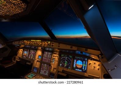 Jet aircraft cockpit at twilight time.