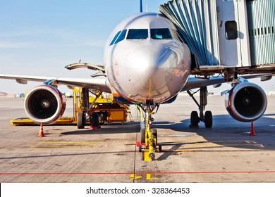 Jet aircraft docked in airport