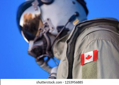 Jet aircraft pilot flight suit uniform with Canada flag patch.