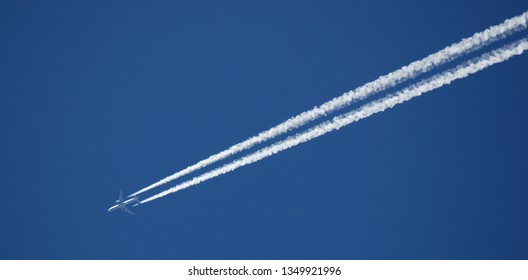 Jet airplane flying the blue sky trace of the plane in the sky bright day