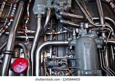 Jet Engine mechanical and electrical working parts. Pipes, Wires, Tubes and Big Red Button.