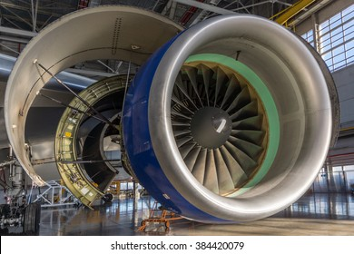 Jet engine open and ready for maintenance inside hangar