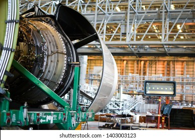 Jet engine remove from aircraft for maintenance at aircraft hangar.Turbine  engine maintenance and change part by aircraft technician .