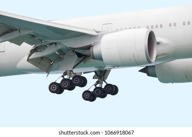 Jet engine and wing with flaps, rubber wheel chassis, close-up before landing at the airport