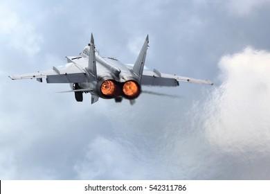 Jet fighter taking off with afterburner.