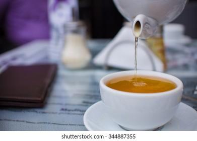 Jet of green tea in restaurant