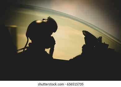 Jet pilot , clothing for pilots or pilots suit , The military pilot in the plane in a helmet in dark blue overalls against the blue sky