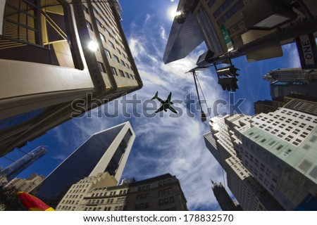 A jet plane flying over skyscrapers, New York City