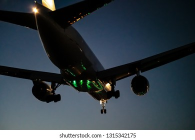 Jet plane landing scene at dusk