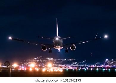 Jet plane landing scene in the night.