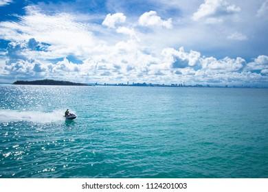 Jet ski riding on the sea.