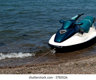 Jet ski tethered in the water on the shore of Lake Erie