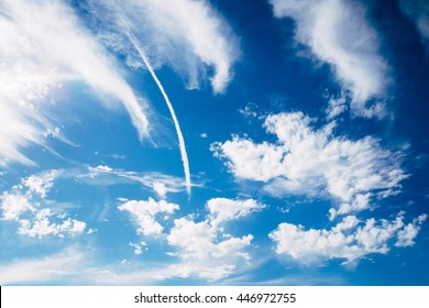Jet smoke and deep blue sky with white clouds