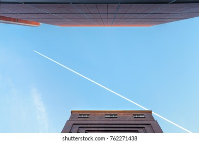 Jet Trail across a Blue Sky, with Architecture Details