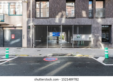 Jette, Brussels Capital Region / Belgium - 10 02 2019: Steel garage port and fence of an upper class residential apartment block