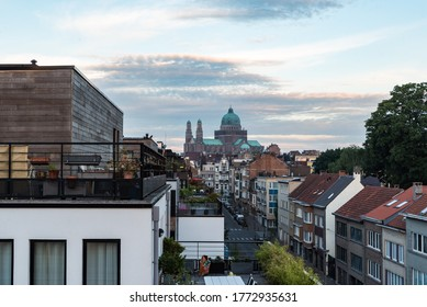 Jette, Brussels Capital Region / Belgium - 06 29 2020: View over a residential street with modern and renovated apartment blocks