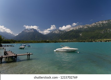 Jetty and boats on Lake Annecy France