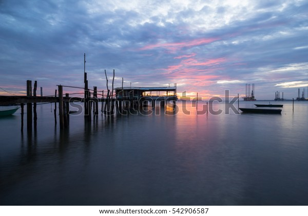 jetty with boats views on dramatic sunset