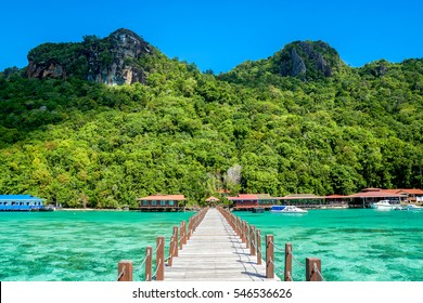 Jetty to Bohey Dulang Island in Sabah, Malaysia, one of a few islands in Sabah made of volcanic rock. The island is famous for its clear crystal water, beautiful corals and scenic mountainous view