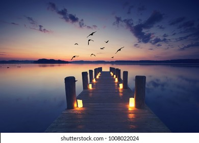 jetty with burning candles, romantic date, idyllic place