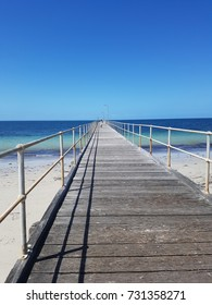 the jetty to the deep blue sea