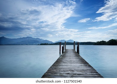 Jetty at lake Chiemsee in Bavaria, Germany, with view to the alps