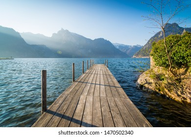 Jetty at lake Traunsee in the mountains of Austria