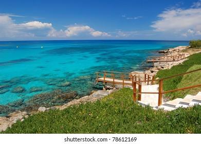 Jetty leading to beautiful lagoon beach on Cyprus island