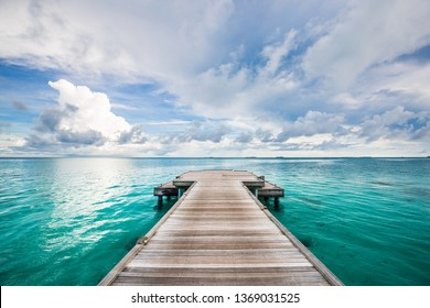 Jetty leads to the sea. Find your way and purpose in life. Wooden road and way to the future and new discoveries. Freedom, success, start concept. Rest, travel and enjoy life, relax view and calmness