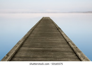 Jetty on misty Azur lake in Aquitaine near Biarritz in France
