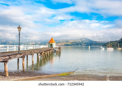 jetty pier building on lake at Akaroa New Zealand