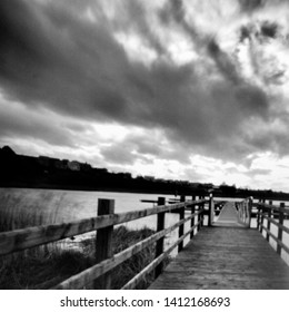 jetty at the river erne, enniskillen, fermanagh,, this black and white photo is NOT sharp due to camera characteristic. Taken on analogue photographic medium format film with a pinhole camera.