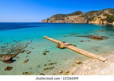 Jetty sea horizon beach bay mountains, Camp de Mar, Majorca island, Spain