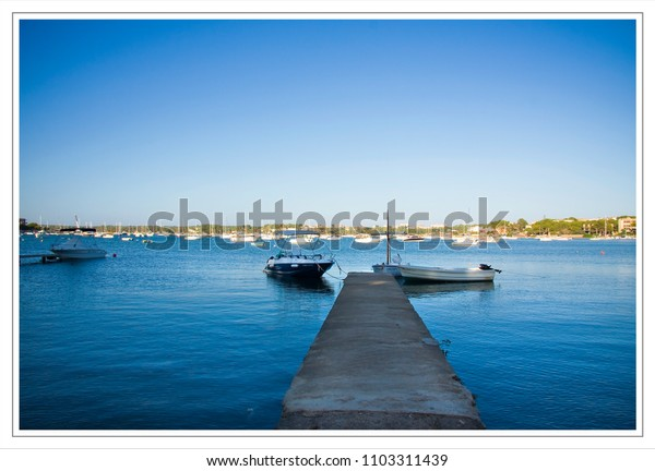 jetty in a still harbour