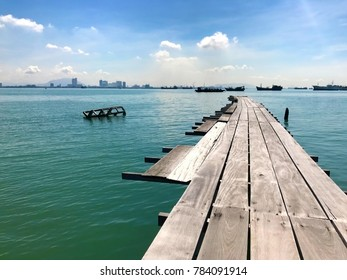 jetty with view of container ships, penang, malaysia