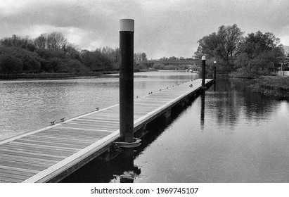 jetty without a boat and wide river analogue picture taken with a black and white film