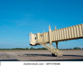 Jetway with no airplane in airport on blue sky background with copy space. Air bridge for passenger in the airport.