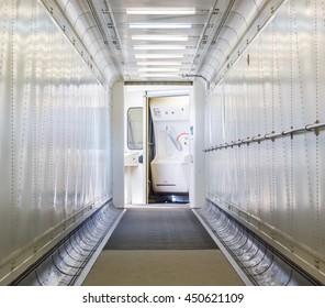 Jetway, walking towards the plane, seeing the door of the plane, selective focus