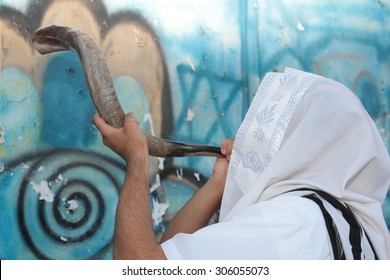 Jew blowing the shofar of Rosh Hashanah (ram's horn).