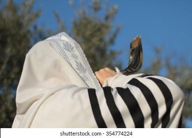 Jew blowing the shofar of Rosh Hashanah