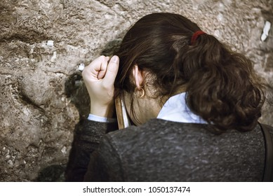 The Jew woman prays near the Western Wall / Kotel in the Old City of Jerusalem, Israel