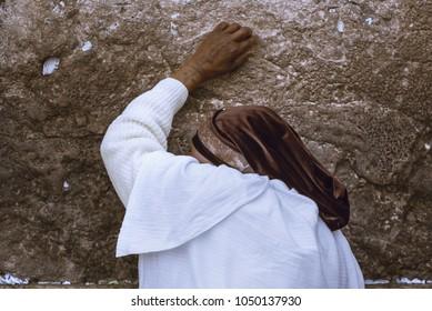 The Jew woman prays near the Western Wall / Kotel in the Old City of Jerusalem, Israel