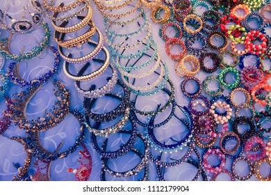 Jewel and gem for sale on market. Colorful traditional uzbek ancient handcraft jewellery in the bazaar in Bukhara, Uzbekistan
