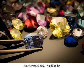 Jewel or gems on black shine color, Collection of many different natural gemstones amethyst, lapis lazuli, rose quartz, citrine, ruby, amazonite, moonstone, labradorite, chalcedony, blue topaz