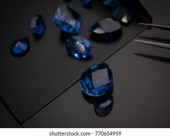 Jewel or gemstone on black shine table , Collection of blue sapphire