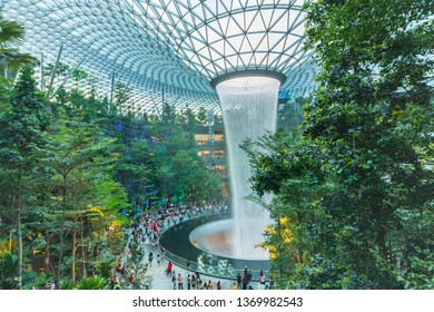 Jewel, Singapore-12 Apr 2019: A Rain Vortex inside the Jewel, Changi Airport is a 40 metres high and world's tallest indoor waterfall. It will project the stunning light-and sound show in the evening.