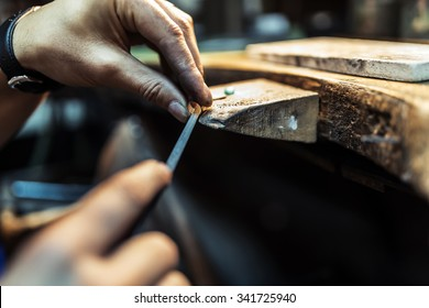 Jeweler crafting jewelry on his workbench