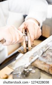 Jeweler making jewelry in a goldsmith workshop
