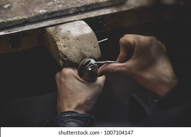 Jeweler using tools to create a ring