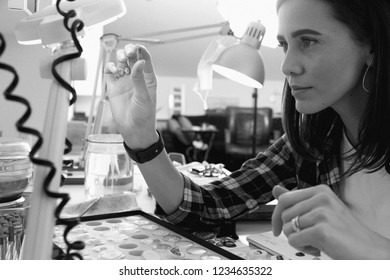 Jeweler at work, crafting in a jewelry workshop.